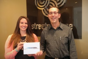 Walt Teichen poses with Rebecca Roerig of Streeter Place, our 2014 CAA iPad winner