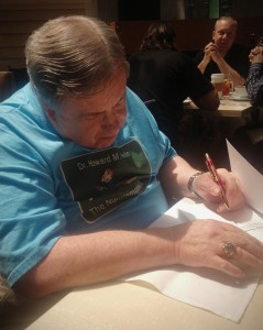 "Dr. Howard M. Berlin signing his book ""The Numismatourist"" at the World's Fair of Money 2014"